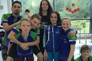 Swimmers and coaches from the Buxton club at the Derventio gala.