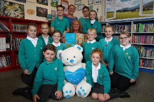 Headteacher Mrs Donna Adams and Mrs E Fisher with happy pupils.