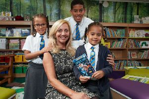 Author Hilary Robinson opened the library with Candice's children Solomon, Hannah and Amelia Woodcock.