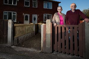 Path to nowhere: Mr and Mrs Gelder outside their home next to reclaimed land.