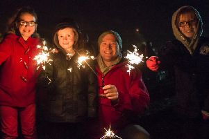 Mia Burke with Joseph, Mark & Imogen Wipper at the Thornes Park bonfire in 2013.