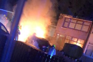 Fire engulfs a car outside Kirklees councillor Masood Ahmeds home in Dewsbury.