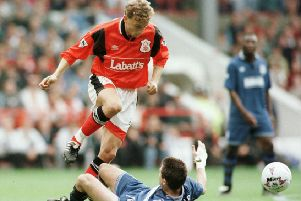 17 SEP 1995:  LARS BOHINEN OF NOTTINGHAM FOREST KNOCKS THE BALL PASSED THE CHALLENGE OF ANDERS LIMPAR OF EVERTON   DURING NOTTINGHAM FOREST V EVERTON IN THE FA PREMIERSHIP AT CITY GROUND. Mandatory Credit: Shaun Botterill/ALLSPORT