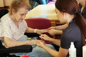 A patient feels the soothing hands of Nelson and Colne College student Phoebe Young at Pendle Community Hospital