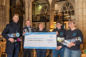 A team of workers from Normanton have donated 500 to a homeless charity.