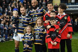 Leeds Rhinos legends Rob Burrow and Jamie Jones-Buchanan are pictured at the testimonial match with their children.'Picture: Jonathan Gawthorpe.