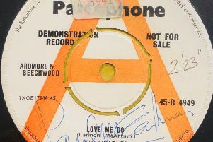 The first Beatles record to be played on the radio which is being sold by the auction house on January 28 - complete with the misspelling of Sir Paul McCartney's name.