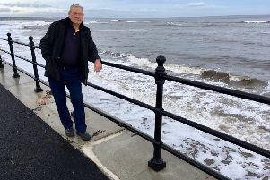 Headland resident Alan Cook by the affected coping stones.