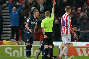 Luke Ayling appeals to referee Gavin Ward after Pontus Jansson (on the ground) is red carded at Stoke City. Picture: Bruce Rollinson