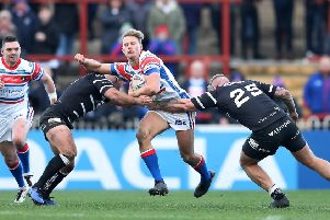 LEADING MAN: Wakefield Trinity's Jacob Miller in action against Hull FC's Danny Houghton during a pre-season friendly.