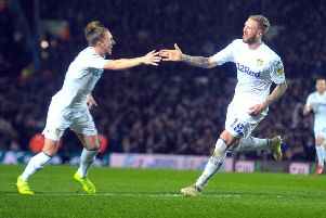 Pontus Jansson celebrates scoring with teammate Luke Ayling. Picture: Tony Johnson