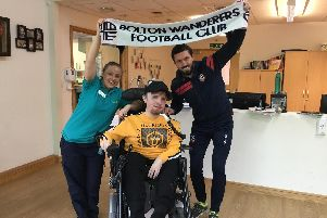 Derian House ambassador, Bolton Wanderers footballer Jason Lowe with charity member Claire Harding and service user Adam