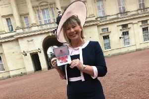 Anne-Maria Newham with her MBE at Buckingham Palace.