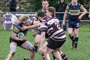 Old Crossleyans v Old Rishworthians'Crocs'  Ryan Hammond tries to fend off an opponent