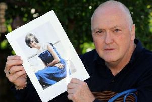 Colin Frost holds a photo of his sister Elsie, who was murdered at the age of 14. Pic: Scott Merrylees