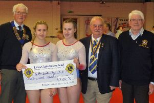 Ruby Simpson and Lily Grainger receive the cheque from Lions members Richard Traves, Les Taylor and Derek Boyland.