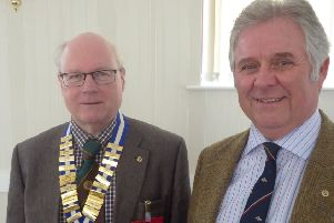 Pocklington Probus Club chairman Christopher Dodd with speaker Eddy Dawson.