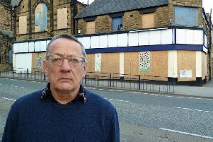 Eyesore - Harrogate Borough Council Coun Philip Broadbank with the ex-McColls site behind him in Starbeck in Harrogate.