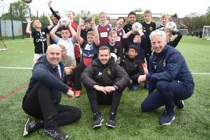 Port of Tyne head of operations Graeme Hardie (left0 with South Shields FC player and Foundation coach Blair Adams and SSFC Foundation Head Steve Camm and children at the club's Let's Play Thursday session.