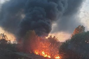 The fire produced lots of thick, black smoke