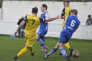 Sam Liversidge (number 7) scores a goal for Frickley Athletic at Pontefract Collieries in the season just finished.