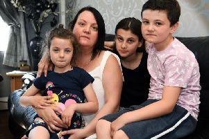 Lisa Thompson with children Ava-Grace six, Isabella, 12, and Andre, nine. Picture: Jonathan Gawthorpe.