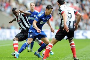 The FA Trophy Final.'FC Halifax v Grimsby Town.'Halifax's James Bolton takes on Grimsby's Jon-Paul Pittman.'22nd May 2016.'Picture : Jonathan Gawthorpe