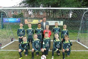 Hibernian head coach Paul Heckingbottom with Ryhill FC juniors