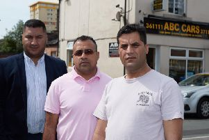 Taxi driver Muhammad Akram (right) was left for dead by passengers who beat him unconscious and robbed him. He is pictured with Wajid Ali, co-chairman of Wakefield District Private Hire and Hackney Association and Yasar Ahmen, association treasurer.