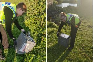 PCSOs Steve Dye and Jess Pick dealt with the snake before releasing it near the canal. Pictures: West Yorkshire Police