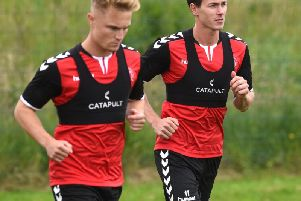 Kyle Dempsey (left) has a point to prove in pre-season after being loaned to Peterborough in January