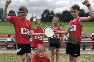 The successful High Peak AC youngsters with their trophy.