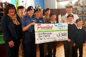 Proudfoot director Valerie Aston presents the cheque to the Sea Cadets.