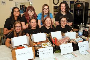NCS students pictured with their food boxes and recipe cards.