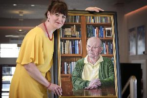 Lynne Arnison with her portrait of the playwright