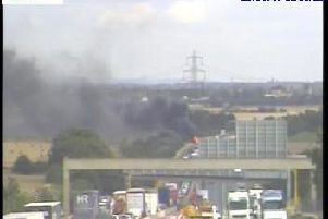 A vehicle fire has caused congestion on the M62 near Ferrybridge today. Photo: Highways England