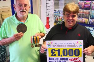 Peter and Steven are blazing the trail at Coal Clough Lane Post office to collect one million pennies for Pendleside Hospice.