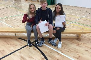 Thumbs up for this trio of successful GCSE students at Burnley High School