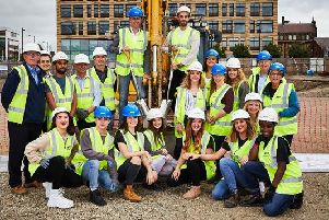 Work on a state-of-the-art performing arts facility for students of CAPA College has officially begun. Pictured are staff and students with contractors from Clugston Construction. Photo: David Lindsay