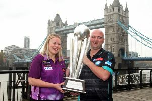 World Champion Rob Cross and Anastasia Dobromyslova, one of two female qualifiers, during a photocall for the 2018/2019 William Hill World Darts Championship