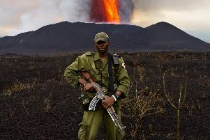 An armed ranger at Virunga National Park during the eruption of the Mount Nyamulagira volcano in 2011