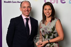 Sonia Farrow, winner of the patient focus award, with  Barry Nee Chief Information Officer of Care UK.
