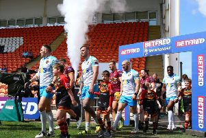 Batley Bulldogs and Dewsbury Rams walk out at the Summer Bash. PIC: Ash Allen/SWpix.com
