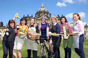 Amy Souter of Carter Jonas (centre) at Castle Howard with food producers (l to r) Wold Top, Riverford Organic Farmers, Bothams, Appletons, Yorkshire Provender and Wensleydale Creamery, who are all supporting the Carter Jonas LandAid Pedalthon.'Picture: Richard Doughty Photography
