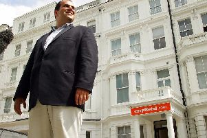 """Cypriot billionaire and entrepreneur Stelios Haji-Ioannou outside his latest venture easyHotel in London, """"Photo credit should read ADRIAN DENNIS/AFP/Getty Images)"""