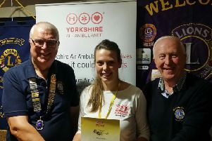 Wetherby Lions president Tim Ritson, left, and Beer Festival organiser Ken Campbell flank the Yorkshire Air Ambulance's Jenny Jones at the cheque presentation.