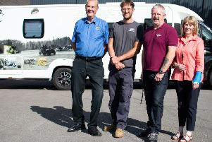 Jonathan Clamp (third from right) who designed the motor home 'wrap' commemorating the Battle of Arnhem with his grandfather Ken Walsh (left) and Graham and Pat Wardle.