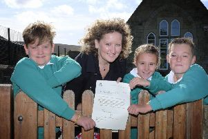 Danby school pupils, Oscar, Sophia and Harry with head teacher Liz Orland