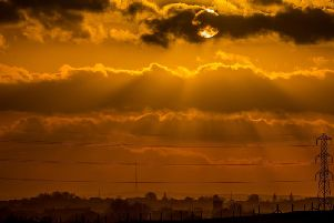 A magnificent sunset over Castleford, looking towards Emley Moor transmitting station, near Huddersfield. Picture: James Hardisty.