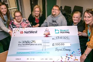 Beyond Housing representatives present a cheque for �500 to Whitby DAG. Photo: Kevin Allen